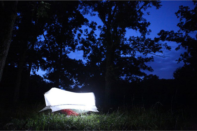 Nube Hammock Shelter by Sierra Madre being used outdoors during the evening