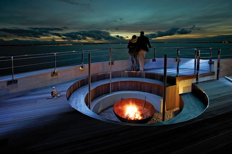 Fire pit and scenery from the Spitbank Fort Hotel on the coast of Portsmouth England