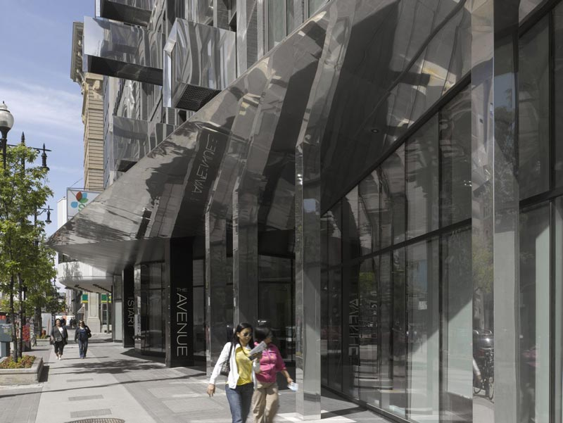 Street level view of The Avenue On Portage by 5468796 Architecture