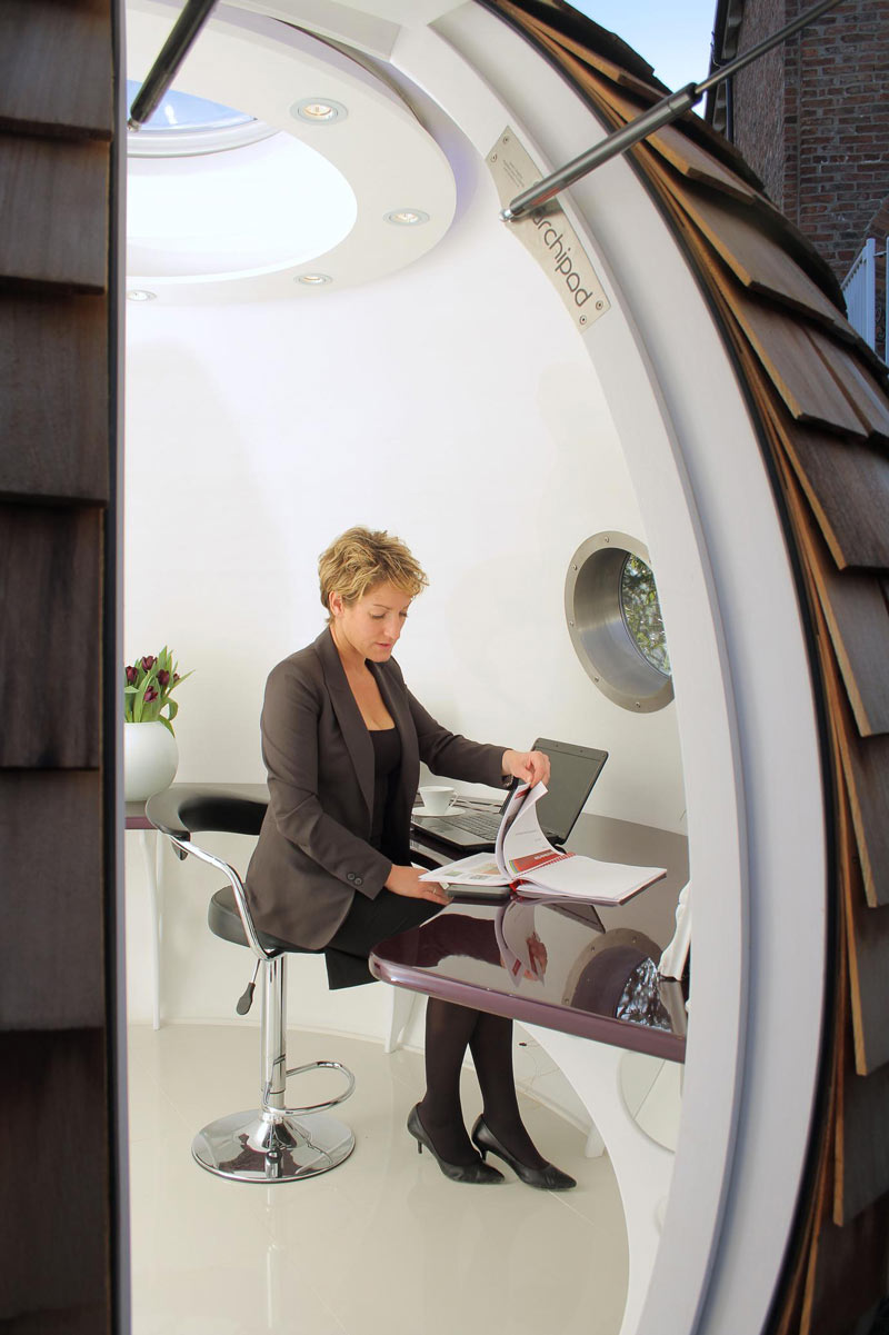 Woman working inside The Pod Garden Office by Archipod