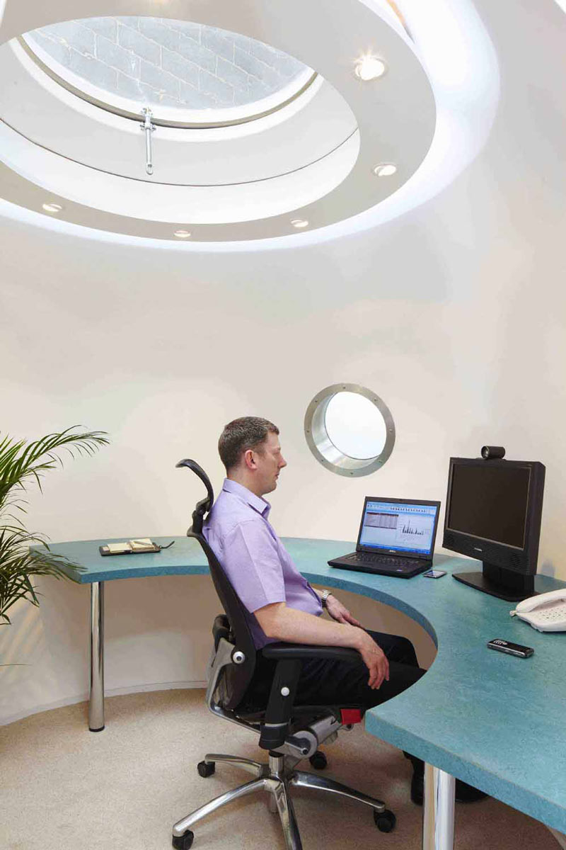 Man sitting inside The Pod Garden Office by Archipod