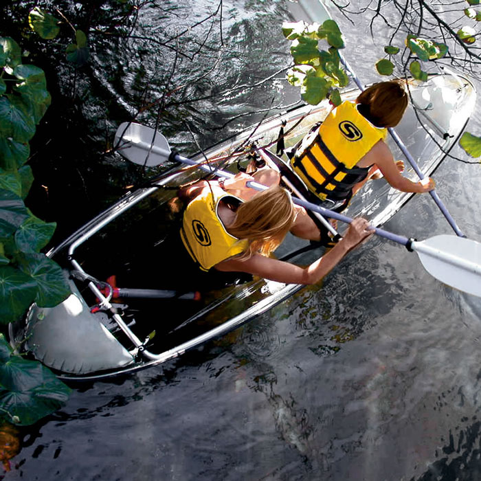 2 people paddling in the Transparent Canoe Kayak by Hammacher