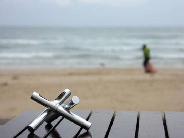 Trea Premium Alcohol Stove by Michael Kononsky on a table near the beach