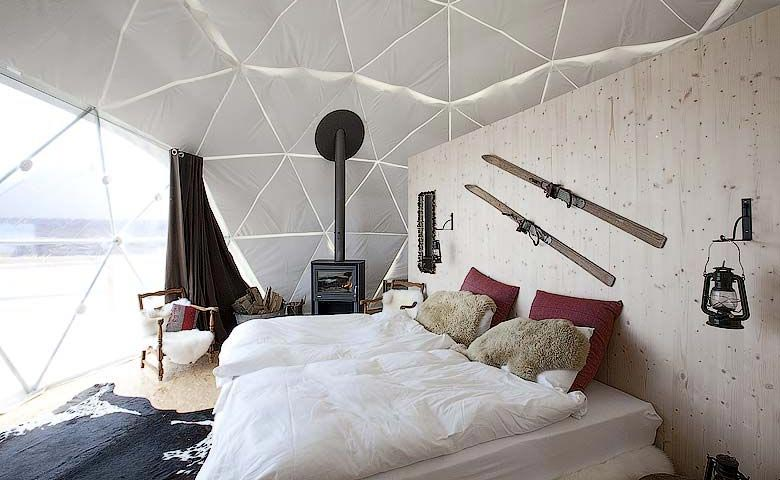 Interior design of a room at the Whitepod Hotel in the Swiss Alps in Switzerland