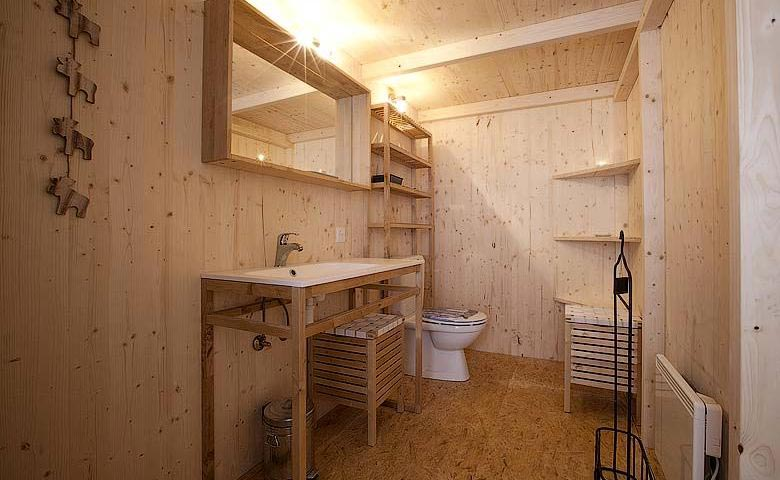 Bathroom with wooden interior design at the Whitepod Hotel in the Swiss Alps in Switzerland