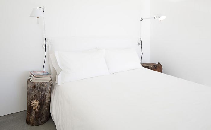 Bedroom with white walls and white sheets at the Casas na Areia in Comporta Portugal
