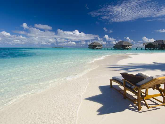 Conrad Maldives Rangali Island Hotel white sandy beach and blue skies
