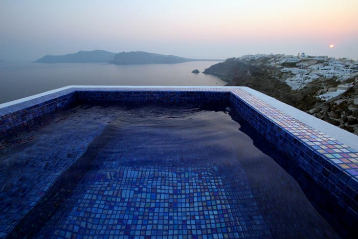 Outdoor pool with a beautiful view at the Ikies Traditional Houses in Santorini