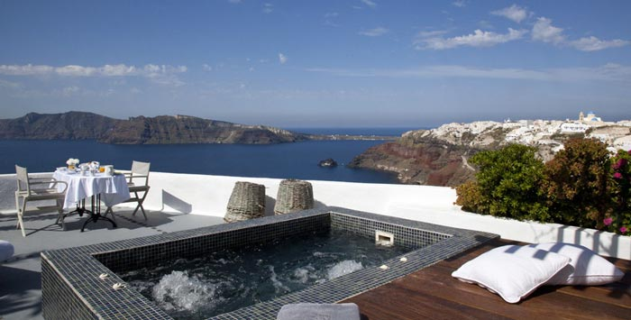 Outdoor jacuzzi at the Ikies Traditional Houses in Santorini
