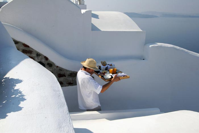 Man working at Ikies Traditional Houses in Santorini