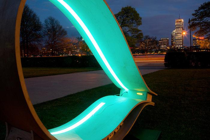 MIT SOFT Rockers Solar Powered Charging Station & Rocking Chair illuminated at night