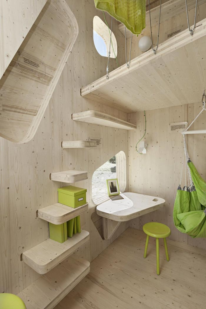 Interior decor of the wooden stairs wooden walls of the Micro Cottage for Students at Virserum Art Museum Sweden