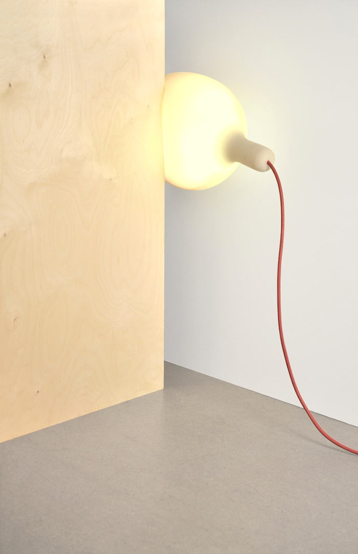 Soft Light Lamp and Pillow by Simon Frambach placed between two walls