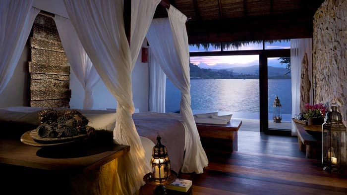 Bedroom interior design at theAerial view of the Song Saa Private Island Resort in Cambodia
