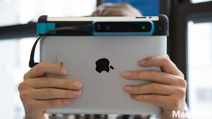 A person holding a Structure Sensor attached to an iPad