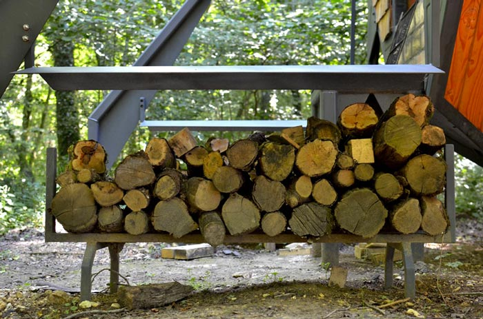 Wooden logs stacked on top of each other