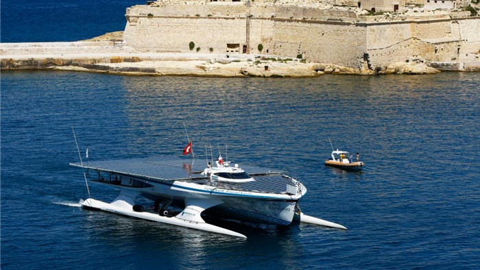 Turanor PlanetSolar World Largest Solar Powered Ship near land