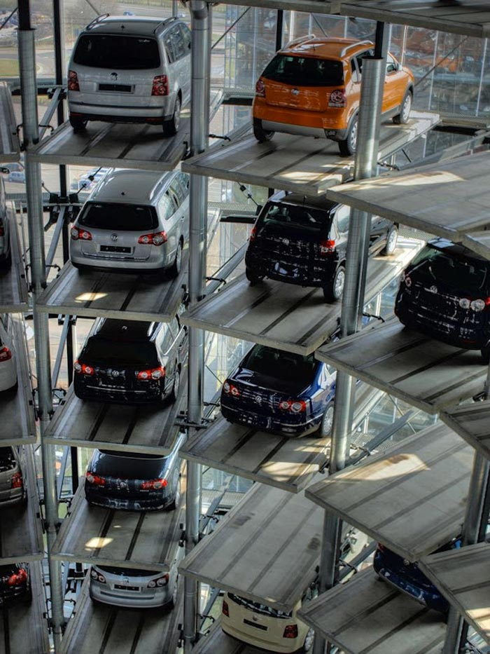 Cars parked in the Architecture at night of the Volkswagen Car Park at AutoStadt by HENN Architekten