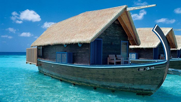 Exterior view of a water bungalow at Cocoa Island Resort in The Maldives by COMO Group