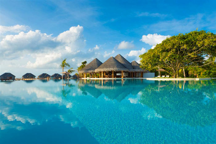 Beach hut at Dusit Thani Maldives Resort in Baa Atoll