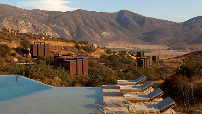 Outdoor swimming pool and lounge chairs at ENCUENTRO GUADALUPE ANTIRESORT IN BAJA CALIFORNIA