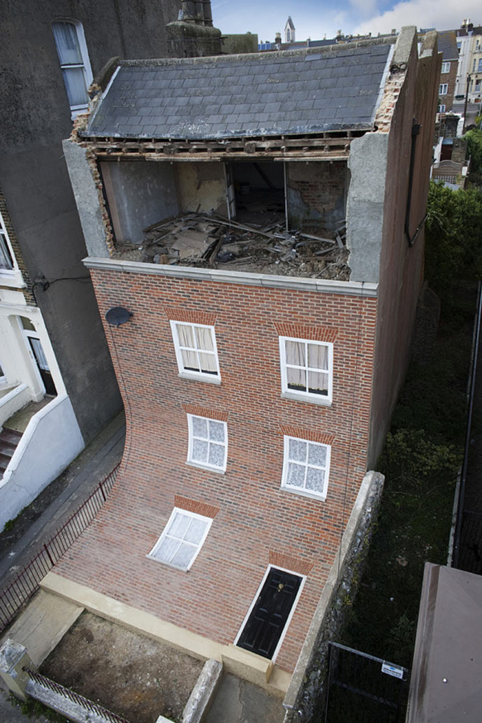 "View of the exterior at ""From the Knees of My Nose to the Belly of My Toes"" by Alex Chinneck"