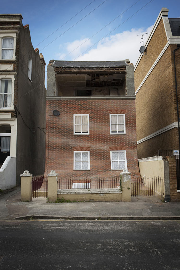 "Facade of the ""From the Knees of My Nose to the Belly of My Toes"" by Alex Chinneck"