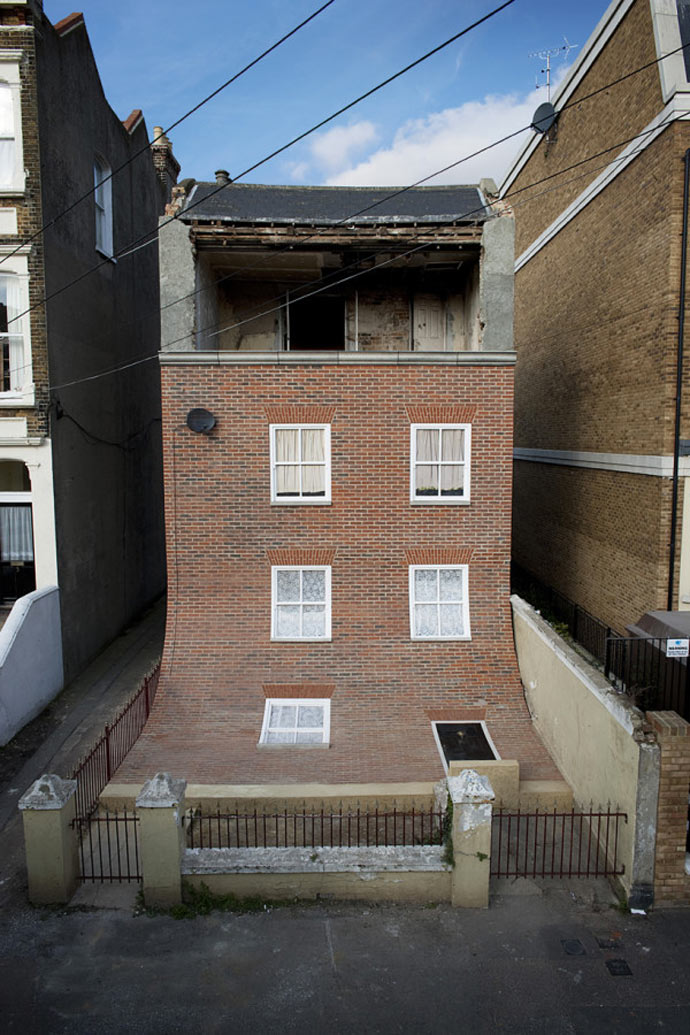 "Facade of ""From the Knees of My Nose to the Belly of My Toes"" by Alex Chinneck"