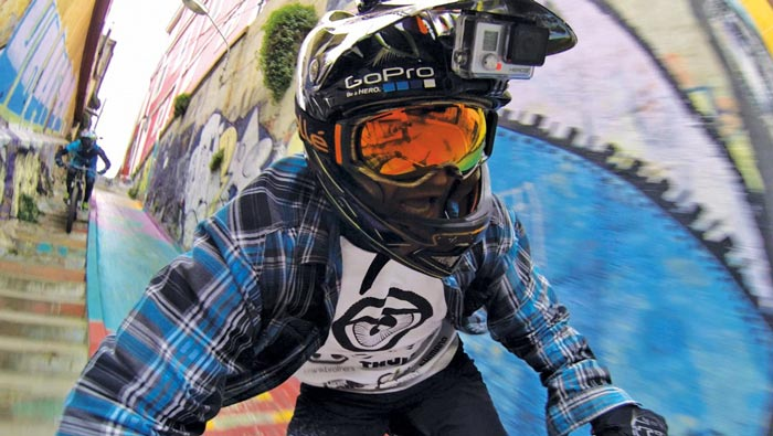 Bicyclist with GoPro Hero3+ HD Action Camera on his head