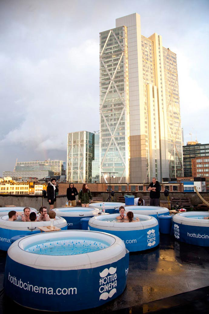 People in Hot Tubs at the Rooftop Cinema at Rockwell House in London during the day