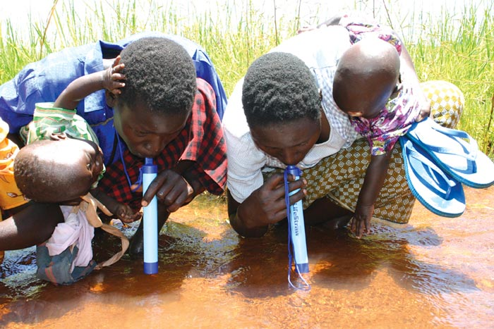 Africans using the Lifestraw Portable Water Filtration System