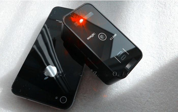 Magic Cube Laser Projection Keyboard Touchpad by Celluon and an iPhone