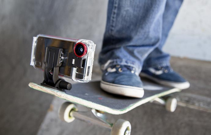 Optrix XD5 Waterproof Action Camera iPhone Case attached to a skateboard