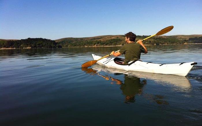 Man using the Oru Kayak - A Portable Origami Folding Boat