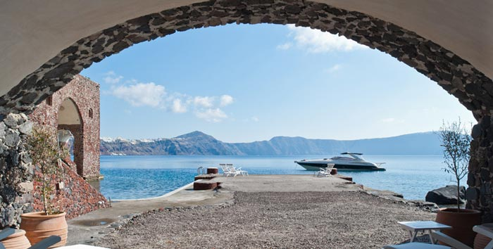 View of the sea and mountains in the horizon at Perivolas Hideaway in Thirassia, Santorini