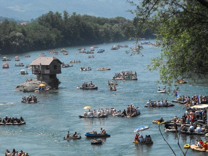 Regatta around a tiny wooden house on the Drina River