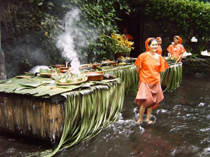 Women cooking at the Villa Escudero Resort Waterfall Restaurant in the Philippines