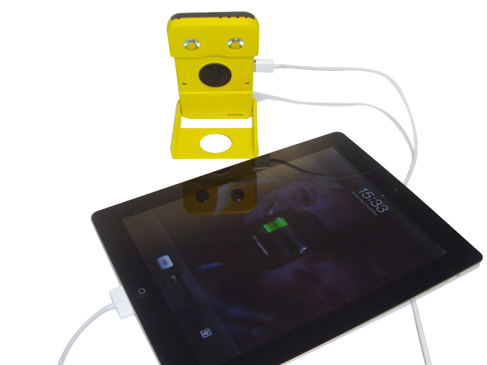 iPad being charged with the WakaWaka POWER Solar LED Lamp and Smartphone Charger