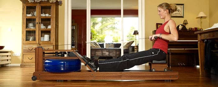 Woman using the WaterRower Rowing Machine Water Rower