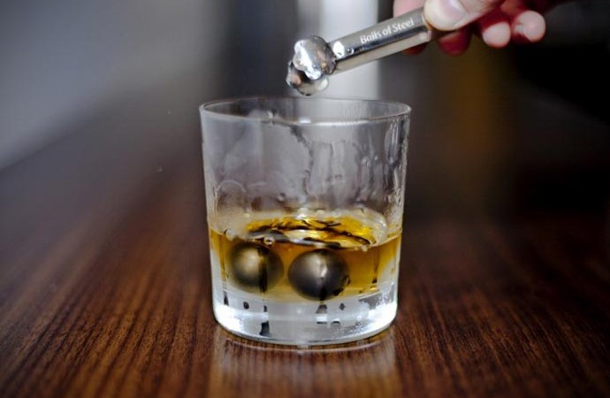 2 balls of steel in a Whiskey glass