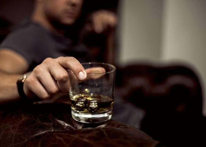 Man using Balls of Steel in his whiskey glass