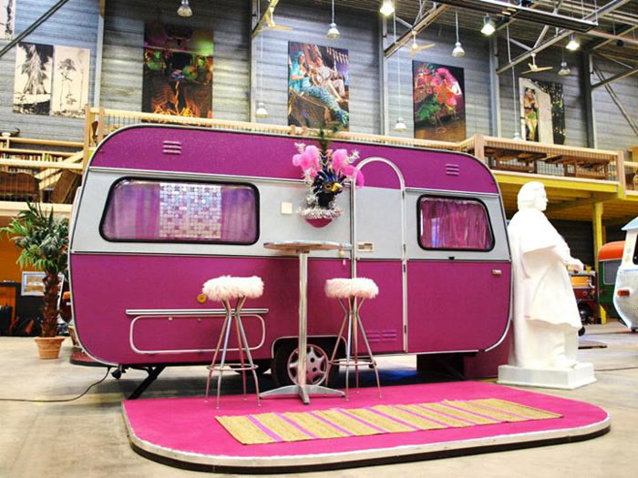A pink trailer at Basecamp Young Hostel