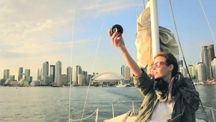 Woman holding the BUBL CAM 360º CAMERA