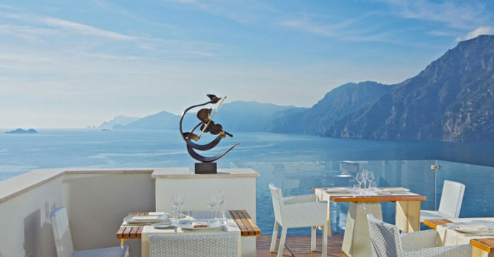 Terrace with table and chairs at CASA ANGELINA IN PRAIANO AMALFI COAST, ITALY