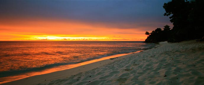 Sandy beach with a view of the sunset at Necker Island