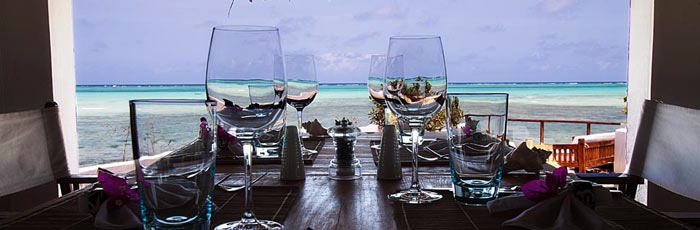 Wine glasses on a table overlooking the ocean
