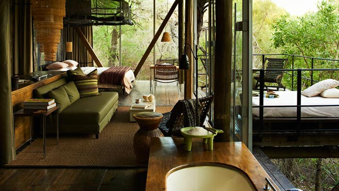 Bathtub and bedroom at Singita Sweni Lodge in South Africa
