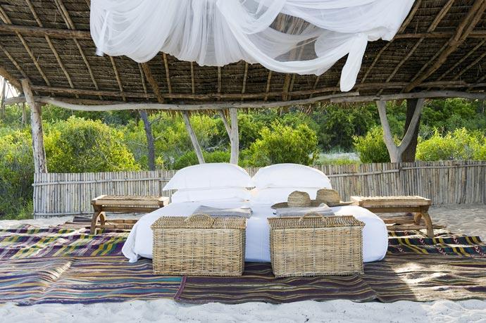 Outdoor bed at Vamizi Island Resort