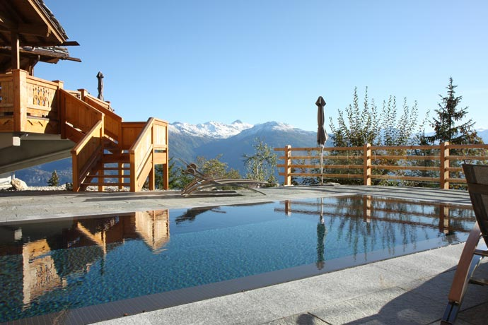 Outdoor pool at LeCrans Hotel & Spa in Switzerland