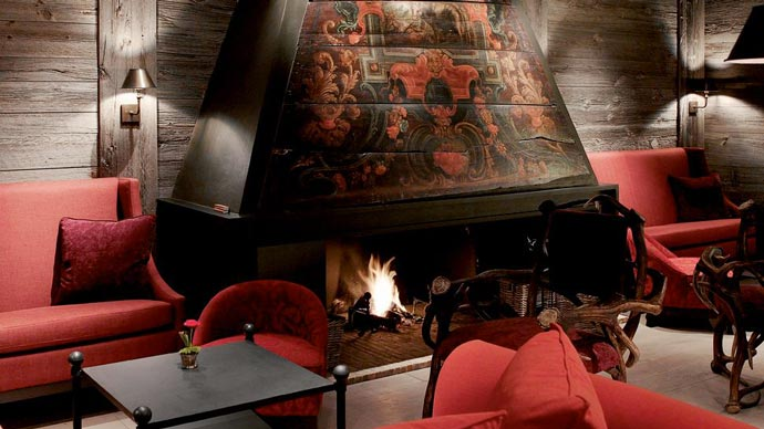 Fireplace at a lounge in LeCrans Hotel & Spa in Switzerland